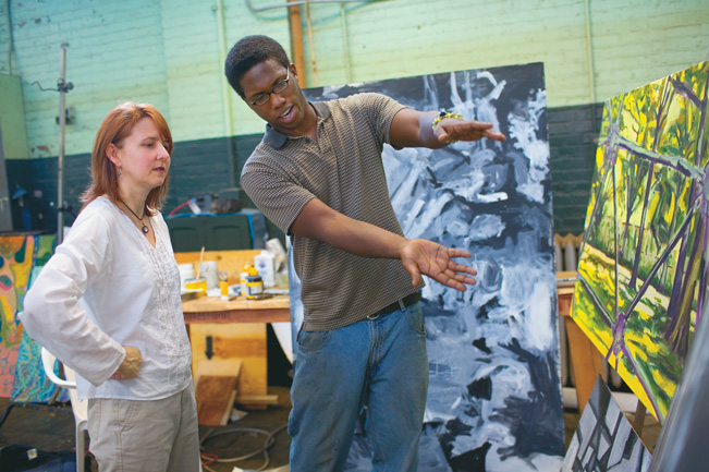 Kelly Scott Kelley and student discuss his work