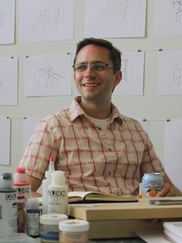 Photo of Matt King seated in studio