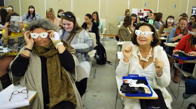 During the home safety workshop led by Carolyn Rubino, students were asked to wear glasses to simulate visual impairment, such as glaucoma, to better identify with the special needs of the elderly. Professor T.L. Ritchie (left) and IFMA, Baton Rouge sponsor DeLisa Arnold (right) tried on the glasses with the students.