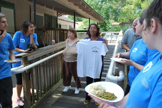 Kim Marshall of Metamorphosis Inc. presents the students with T-shirts