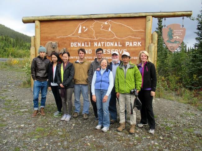 LSU students pose with Ken and Judy Pendleton at the entrance to Denali National Park, Alaska