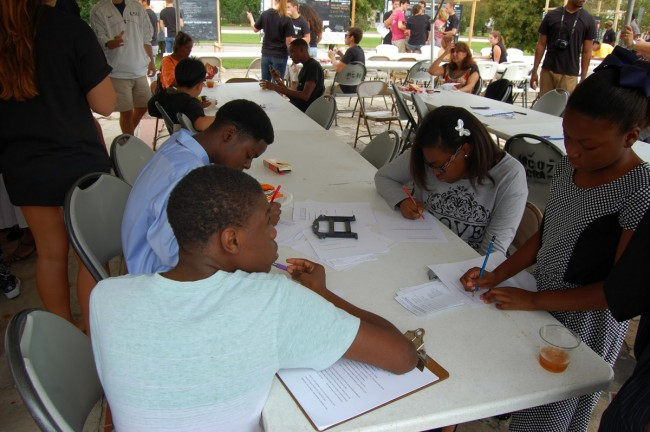 Residents and members of churches adjacent to the project site filled out surveys and chatted with students at Mid City Speaks.