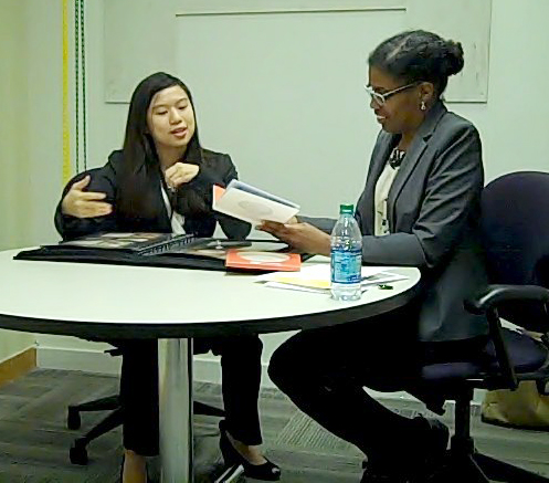 Creative director at LSU Communications & University Relations Jewel Hampton conducts a practice interview with senior graphic design student Christina Chang (left).