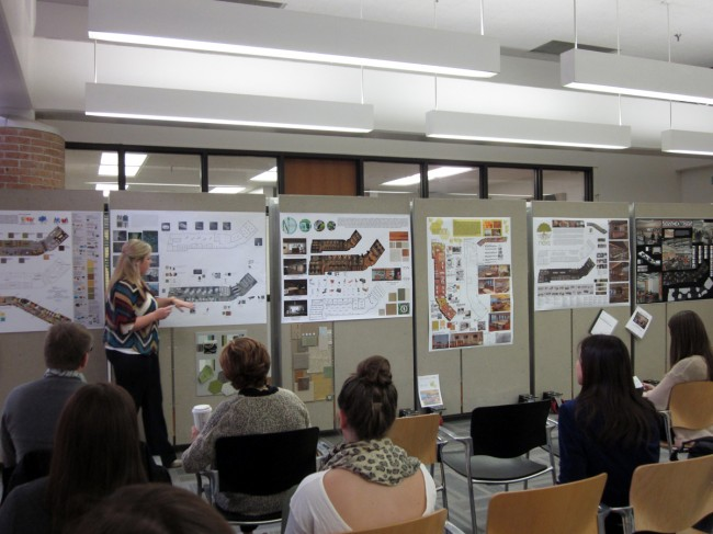 An interior design student presents her final project to faculty, jurors, and peers during fall 2013 final reviews.