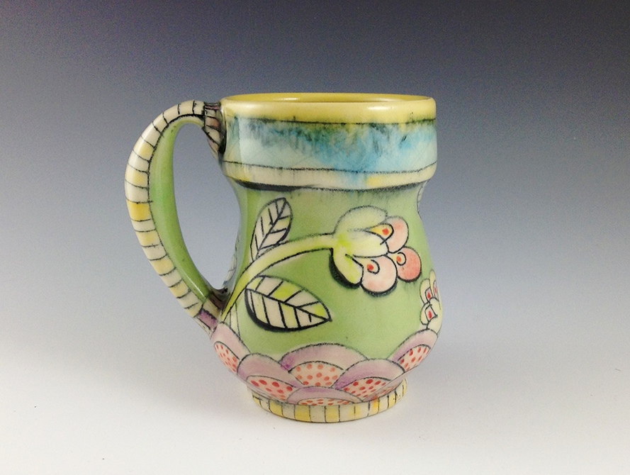 Green mug with pink flower design, glassell gallery 8 fluid ounces chandra debuse