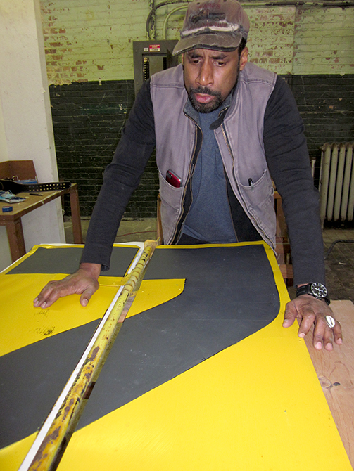 lsu school of art visiting artist nari ward working on neon yellow piece