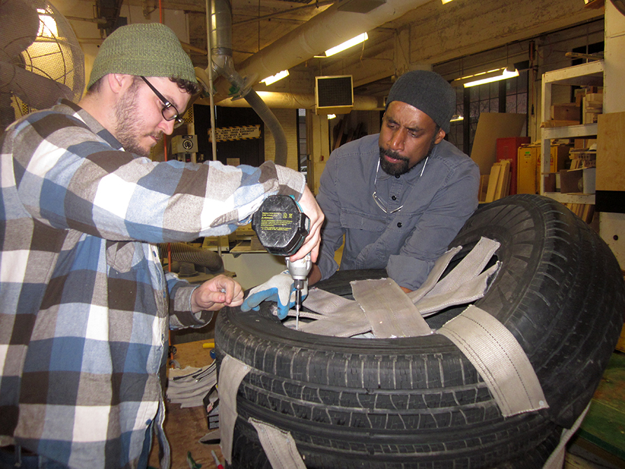 lsu school of art visiting artist nari ward with student working on art project made from car tires