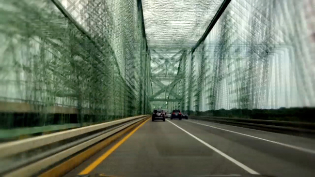 Blurry photo of bridge with cables