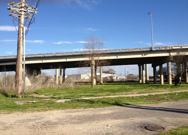 new orleans vacant lot under highway overpass