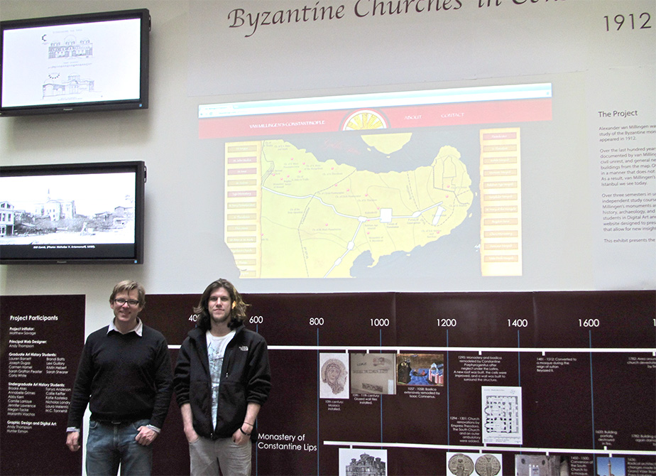 """lsu undergraduate research students stand in front of wall exhibition """"Byzantine Churches in ... 1900s"""""""