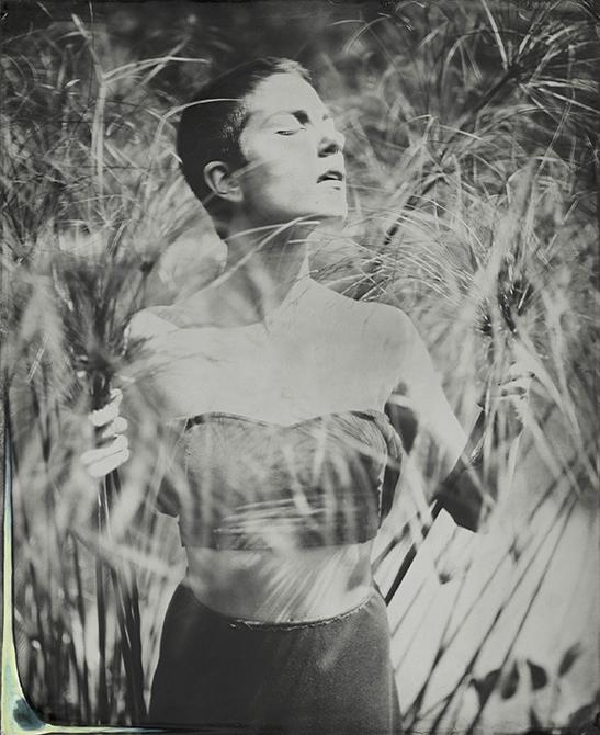 woman among reeds, black and white. lsu photography graduate student Ian Minich