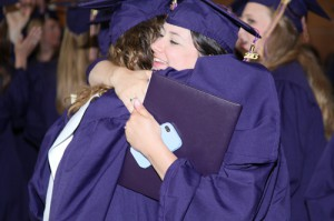 Two LSU Art and Design students embrace at graduation