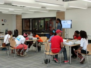 kids at desks in lsu project pipeline summer camp