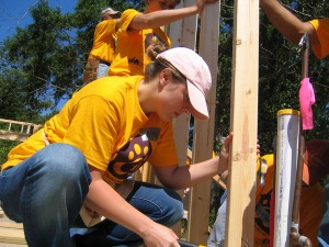 LSU architecture student in yellow shirt builds house for Habitat for Humanity