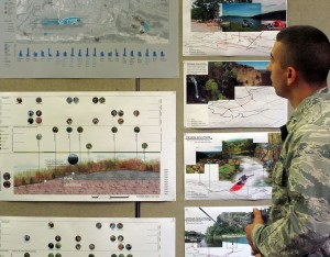 Student in military wear by posters at lsu landscape architecture final reviews