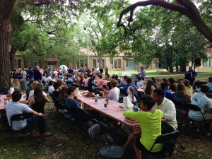People sit at tables in the LSU quad for the lsu architecture oj baker awards