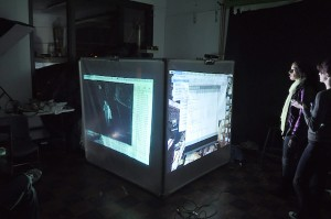 Glowing screen in dim room