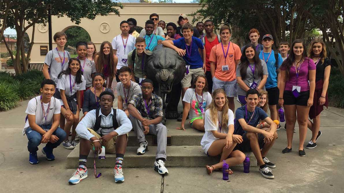 students in lsu architecture camp by Mike the Tiger statue
