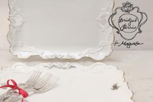 Ornate white platter, silver forks