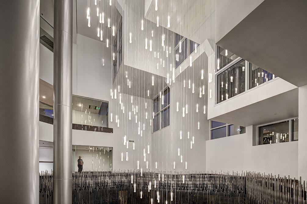 atrium with hanging lights, lsu landscape architecture alumni work