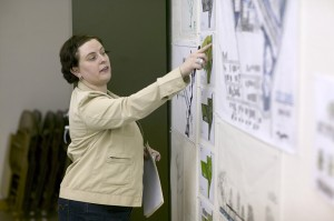 lsu landscape architecture professor points to poster on wall