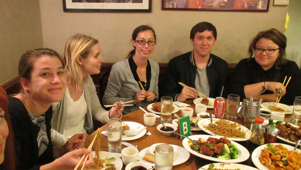Students at table with Chinese food