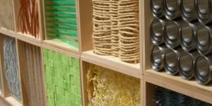 Background image of materials in shelves in LSU School of Interior Design