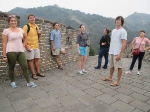 Students on Great Wall of China, mountains in background