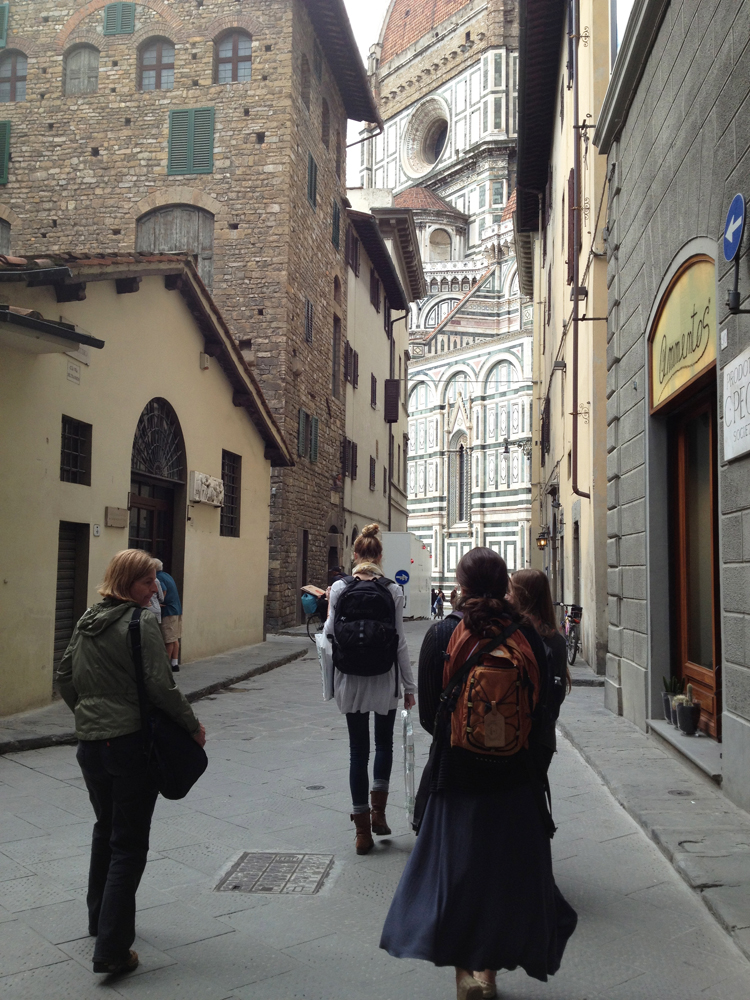 Students walking in the city of Florence, Duomo in the background