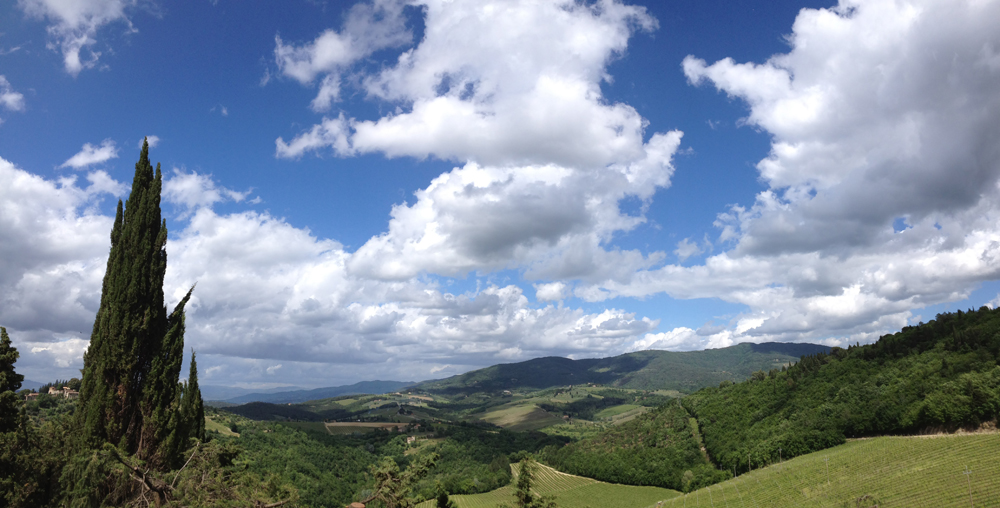 Tuscan countryside, green hills and blue skies