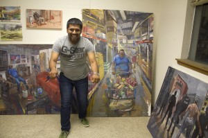 Student smiling in front of paintings