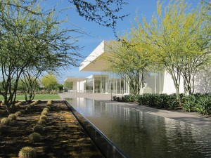 Reflecting pool by modern white building. lsu landscape architecture alumni design