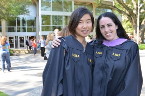two smiling female graduates at LSU commencement