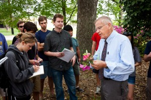 LSU landscape architecture students take notes in park setting as Professor Fryling speaks to group