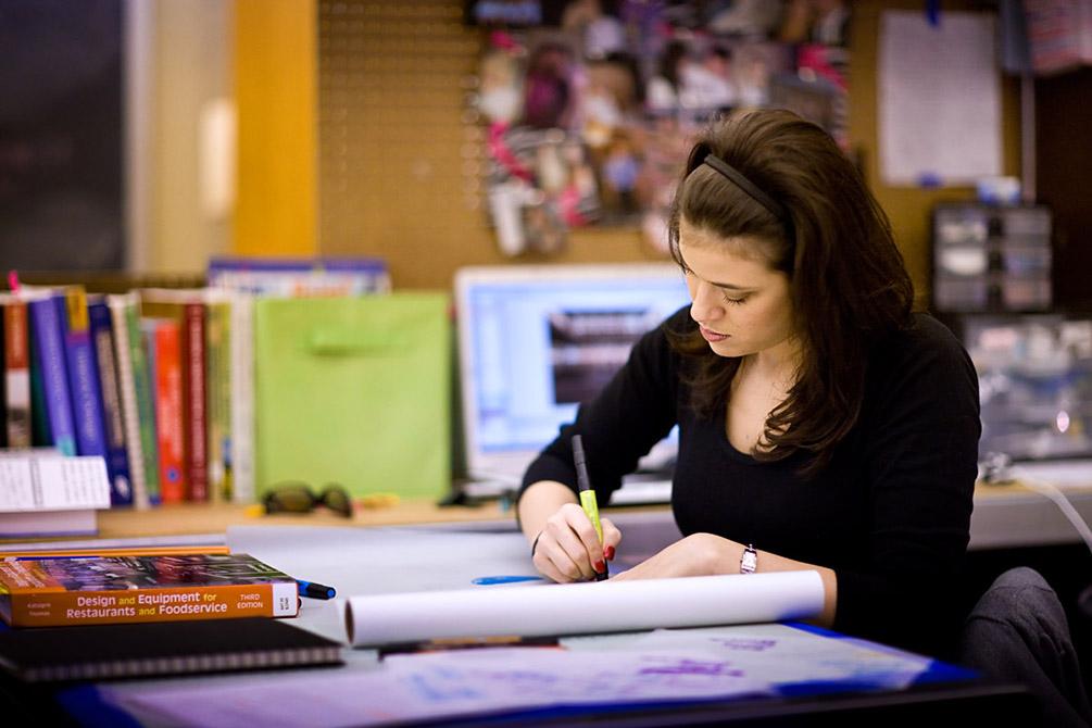 Interior design student working in studio