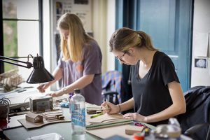 two female students work in lsu architecture studios