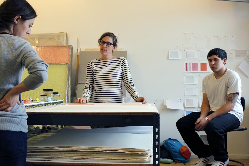 Female artist speaks to students