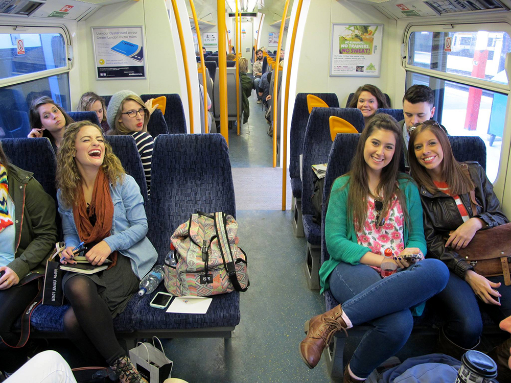 Students smiling on train