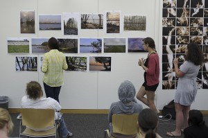 students study photography prints on walls
