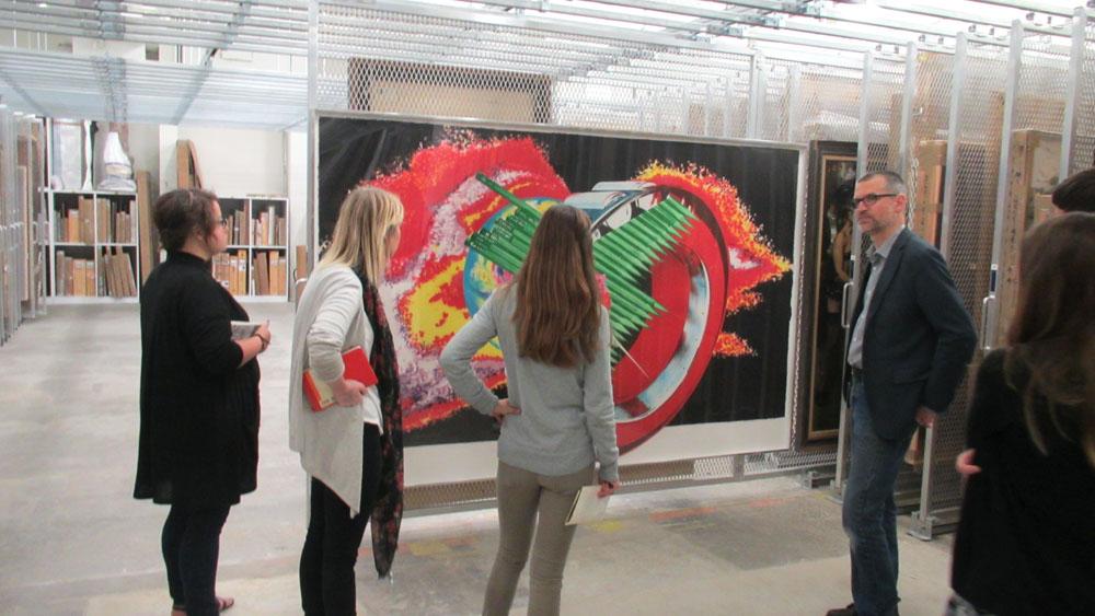 Women looking at colorful artwork