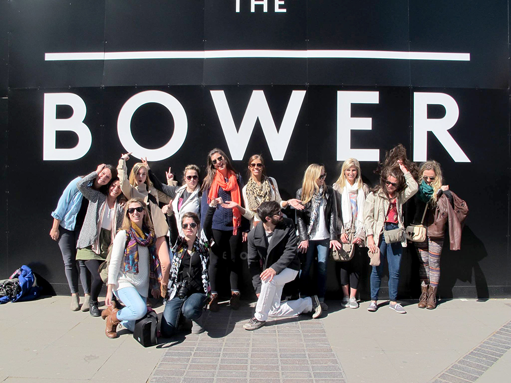 """Students in front of wall with words """"The Bower"""""""