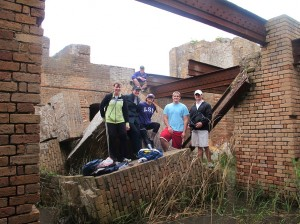 LSU architecture and photography students climb on brick wall ruin at Fort Proctor