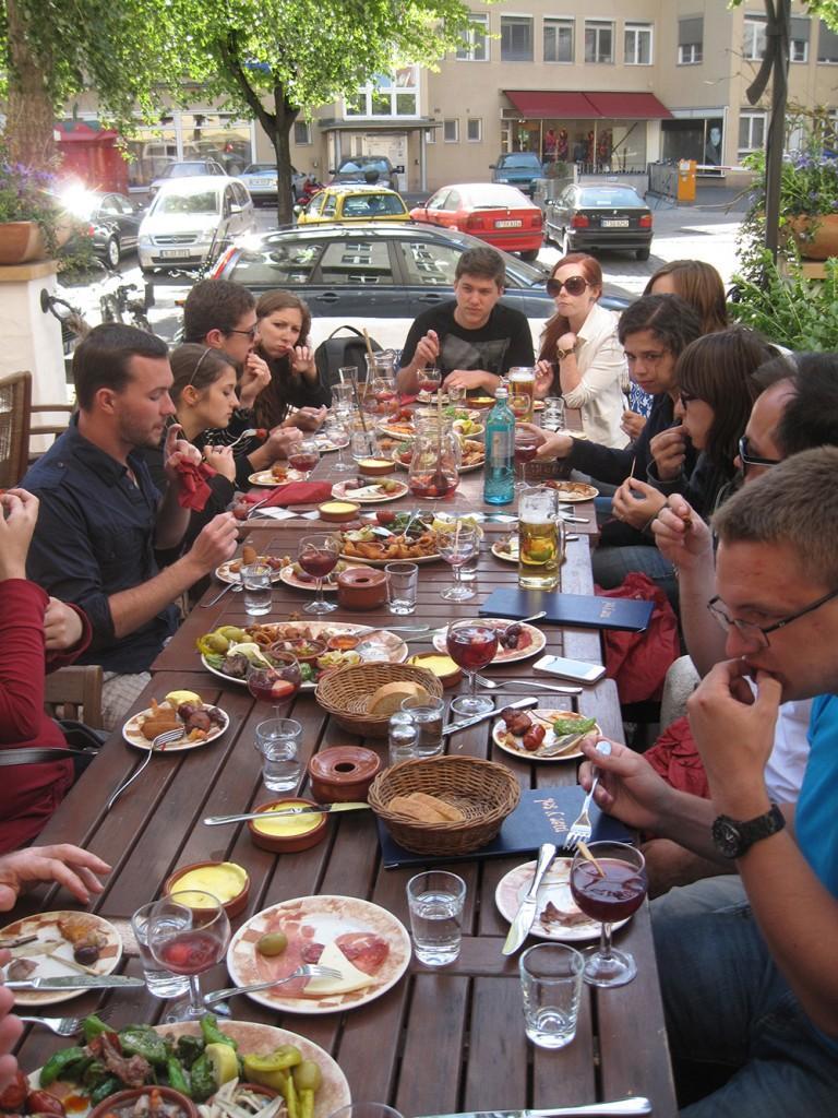 Eating at long table