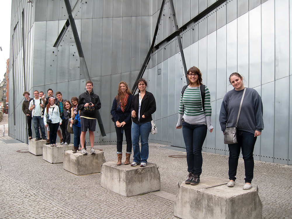Students on pedestals in museum