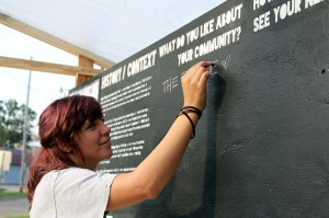 Young woman works on architecture studio project Mid City Speaks