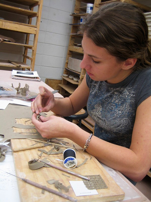 Student works with tools