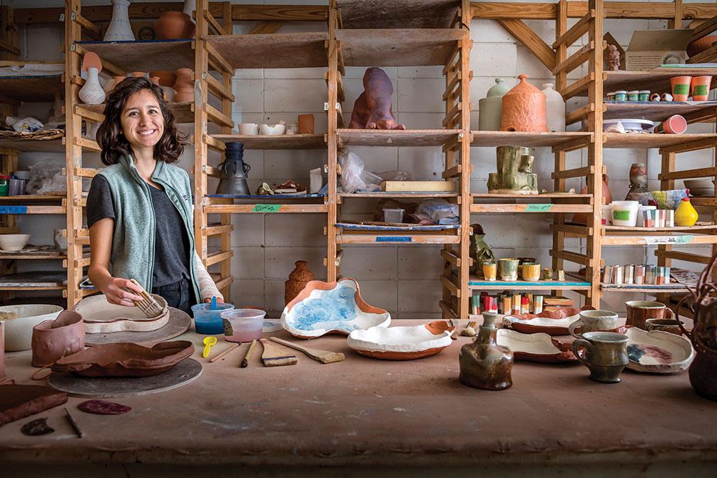 Female student in ceramics studio