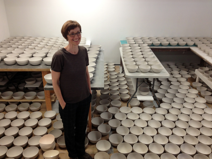 lsu school of art visiting artist with many white ceramic bowls