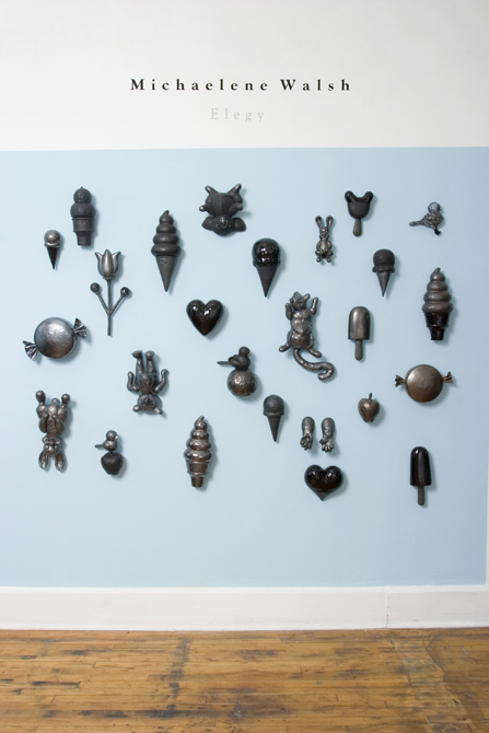 Ceramic shapes on blue wall
