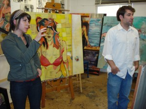 LSU painting & drawing students in studio filled with colorful paintings